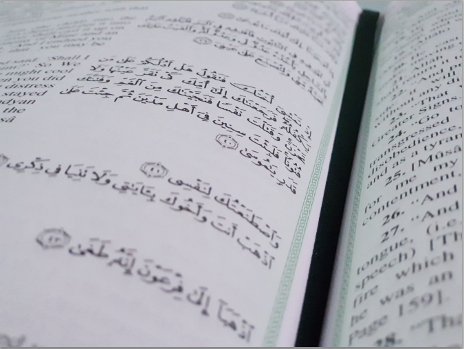 Reading Quran in Arabic
